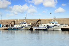 Trawlers fishing boats going to dock after work. Stock Image