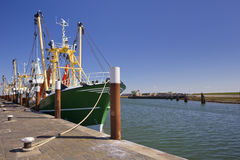 Trawlers in the harbour, Oudeschild, Texel, The Netherlands. Trawlers in the harbour of Oudeschild on the island of Texel in The Netherlands on a sunny day stock image