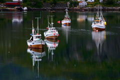 Trawlers in the lofoten islands. Reflected in the sea Stock Photo