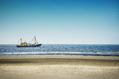 Trawlers in the North Sea. On the beach of St. Peter-Ording on a sunny day royalty free stock image