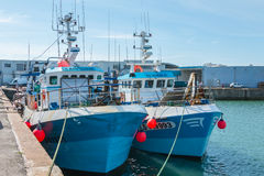 Trawlers are returned to port after fishing off Stock Photos
