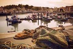 Trawlers in Saint Jean de Luz harbor in France. Fishing net and trawlers in Saint Jean de Luz harbor in Pays Basque, France royalty free stock photography