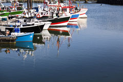 Trawlers in Saint Jean de Luz harbor, France. Row of moored trawlers in Saint Jean de Luz harbor, France Royalty Free Stock Photo