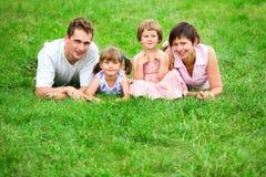 trawy rodzinny lying on the beach obrazy royalty free