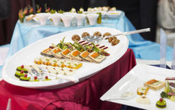 Tray with appetizers on banquet table Royalty Free Stock Photos