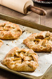 Tray of apple tarts with rolling pin Royalty Free Stock Image