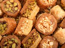 Tray of Arabic pastries. A tray of traditional arabic sweets of the kind that are given at celebrations such as ramadan and eid Royalty Free Stock Photography
