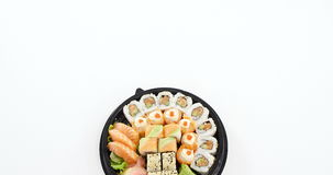 Tray of assorted sushi. Against white background stock footage