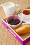 Tray with breakfast: baguette, jam and tea Royalty Free Stock Photo