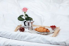 Tray with breakfast on bed. In bedroom Stock Photo