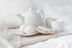 Tray with breakfast on a bed Stock Photo