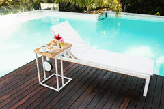 Tray with breakfast in side table and sun lounger Royalty Free Stock Photos