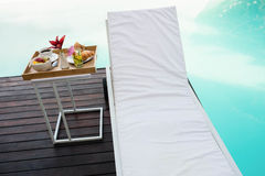 Tray with breakfast in side table and sun lounger Stock Photos