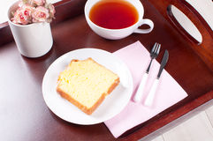 Tray with breakfast tea and lemon loaf Stock Image