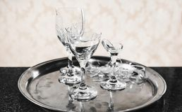 Tray with a broken wine glass on top of a balcony. Broken glass of a party or celebration Royalty Free Stock Photo
