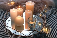 Tray with burning candles. On striped fabric stock photography