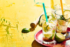 Tray of caipirinha drinks over yellow background Royalty Free Stock Photos