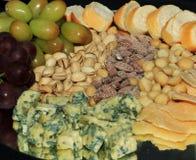 Cheeses grapes delicacies Royalty Free Stock Image