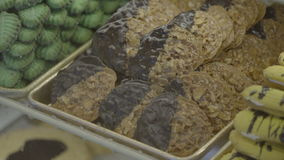Tray of chocolate dipped Florentine cookies. Scene of a tray of chocolate dipped Florentine cookies stock footage