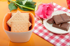 An tray with chocolate and a pink rose Royalty Free Stock Photo