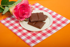A tray with chocolate and a pink rose Royalty Free Stock Photo