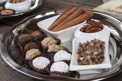 A tray of chocolates and ingredients Royalty Free Stock Photos