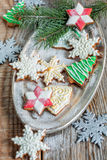 Tray of Christmas cookies and spruce branches. Stock Image