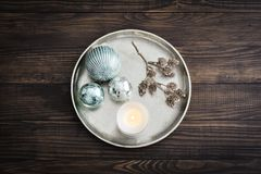 Tray with christmas decorations and candle royalty free stock image