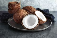 Tray with coconuts. On grey table Stock Image