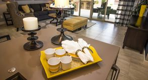 Tray Of Coffee Cups, Plates And Napkins On Kitchen Counter stock photos