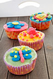 Tray with colorful decorated cupcakes Royalty Free Stock Photo