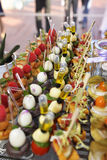 Tray of Colorful Delicious Hors d 'Oeuvres, Beautiful Food, Senses. Tray of colorful bite sized hors d'oevres on skewers stock photo