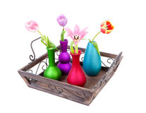 Tray with colorful vases and Dutch tulips Royalty Free Stock Photos