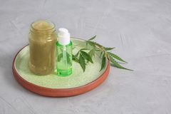 Tray with containers of hemp lotion and oil royalty free stock photos