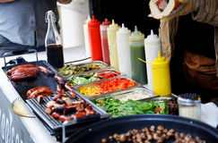 Tray with cooked food on showcase Royalty Free Stock Photos