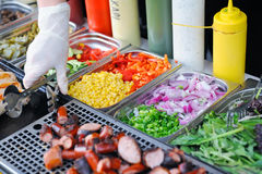 Tray with cooked food on showcase Royalty Free Stock Photo