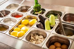 Tray with cooked food on showcase at cafeteria royalty free stock photography
