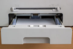 Tray Copier. Open the tray of the copier with paper Royalty Free Stock Photo