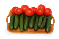Tray with cucumbers and tomato Stock Image