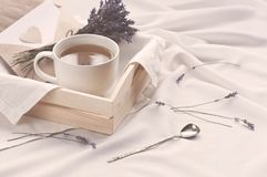 A tray with a cup of hot tea and lavender love letter in bed. Herbal tea Hot drink Mood Love Message Breakfast in bed Morning. Lifestyle royalty free stock photo