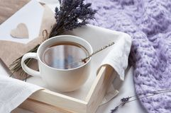 A tray with a cup of hot tea and lavender love letter in bed. Herbal tea Hot drink Mood Love Message Breakfast in bed Morning. Lifestyle royalty free stock photos