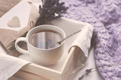 A tray with a cup of hot tea and lavender love letter in bed. Herbal tea Hot drink Mood Love Message Breakfast in bed Morning. Lifestyle royalty free stock images