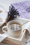 A tray with a cup of hot tea and lavender love letter in bed. Herbal tea Hot drink Mood Love Message Breakfast in bed Morning. Lifestyle royalty free stock image