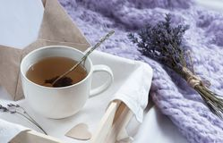 A tray with a cup of hot tea and lavender love letter in bed. Herbal tea Hot drink Mood Love Message Breakfast in bed Morning. Lifestyle royalty free stock photography