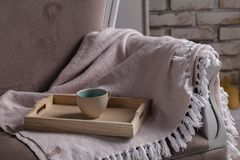 A tray with a cup of hot tea love letter and magazines in bed Stock Photo
