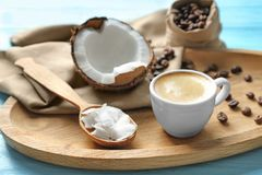 Tray with cup of tasty coconut coffee and nut stock image