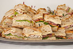 Tray of deli sandwiches. Assortment of deli style sandwiches piled on a platter Stock Photography