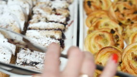 Tray with delicious cakes colseup, indoor stock footage