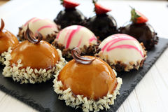 Tray with delicious catering cakes Royalty Free Stock Photos