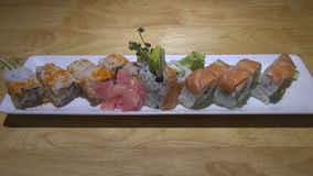 tray of delicious sushi with salmon and flying fish. a slow increase stock footage